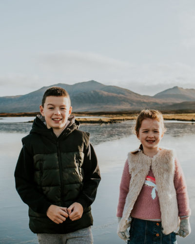 Brother and Sister standing in front of a frozen loch on the Isle of South Uist